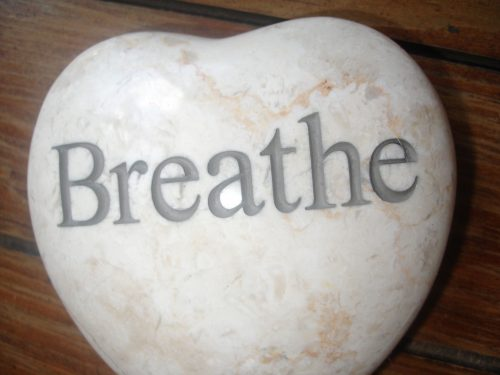 Stone with breathe text