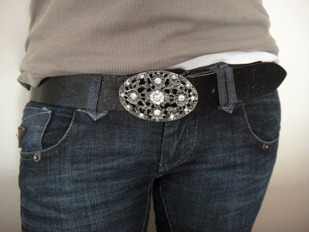 Silver belt buckle around waist