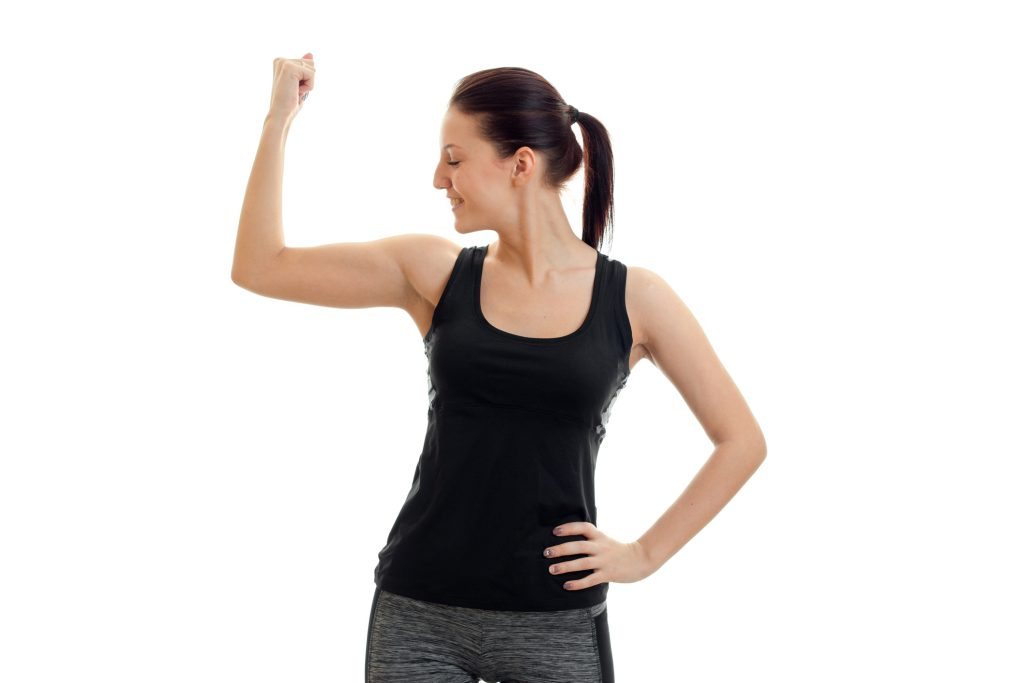 Women flexing arm muscles