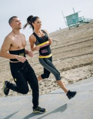 Man and woman running Sweet Sweat waist trimmer belts