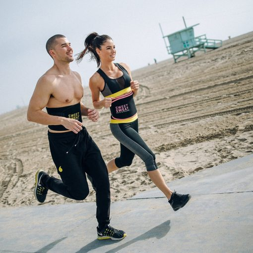 Man and woman running Sweet Sweat waist trimmer belts