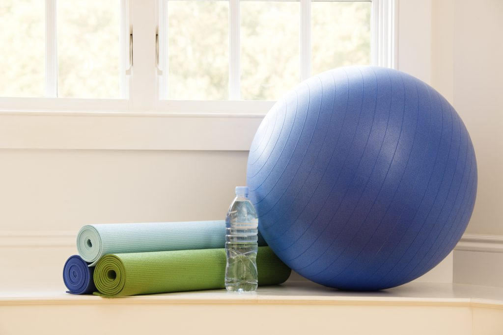 Exercise ball and yoga mat ready for waist training