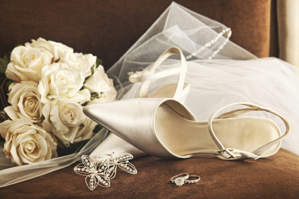 Wedding shoes with bouquet and veil